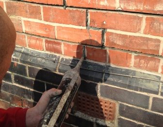 Applying the grout to the repair channel